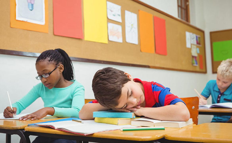 Student asleep on a desk