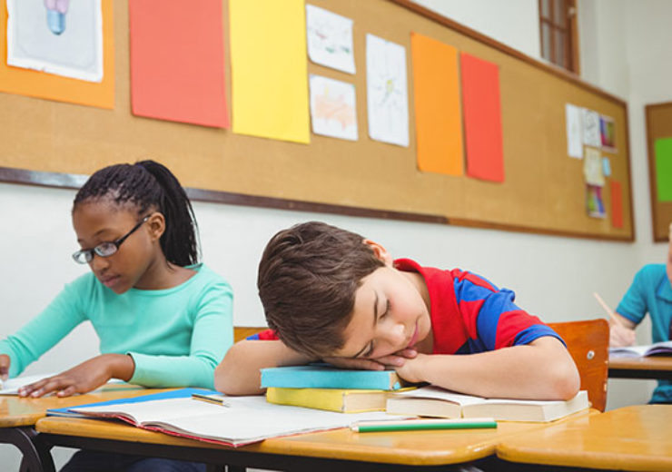 Student asleep on a desk